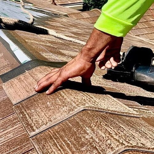 A Roofer Makes a Roof Repair.