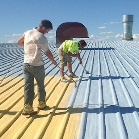 silicone roof coating process with two roofers