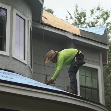 A Roofer Making Repairs.